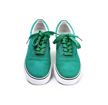 A pair of Green canvas shoes isolated on white background with clipping path