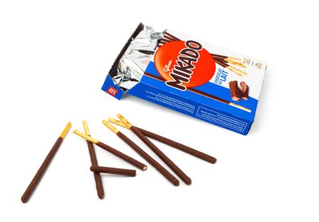 CHISINAU, MOLDOVA - May 20, 2019: Mikado some crunchy chocolate biscuit sticks isolated on white background Editorial