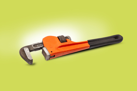 Red pipe wrench isolated on white background. With clipping path Stock Photo