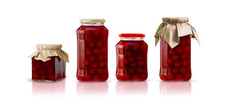Cherry compote in glass jars of different shapes. Isolated on white background.