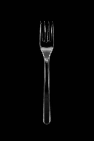 Top view of the transparent plastic fork isolated on black background. Imagens