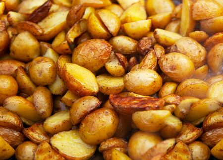 Rustic fried potatoes. Close up background concept 写真素材