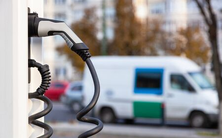Power supply for electric car charging. Electric car charging station. Blurred concept