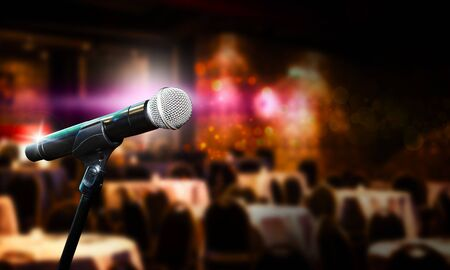 Close up of microphone in concert hall or conference room. Blurred concept Imagens