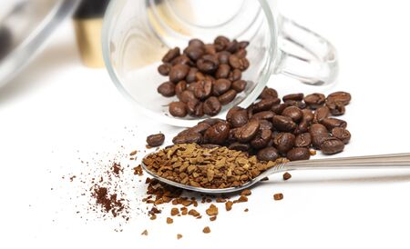 Macro shot of instant granules and beans coffee on a white background.