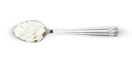 Cottage cheese in spoon isolated on white background with clipping path, view from the top Banque d'images