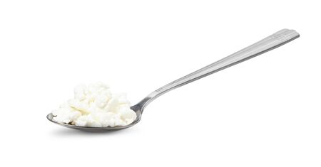 Cottage cheese in spoon isolated on white background with clipping path