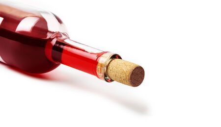Closeup of a red wine bottle on a white background