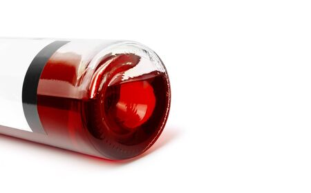 Closeup of a red wine bottle on a white background. With clipping path