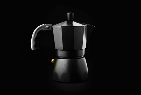 Black Geyser Coffee Maker isolated on black background