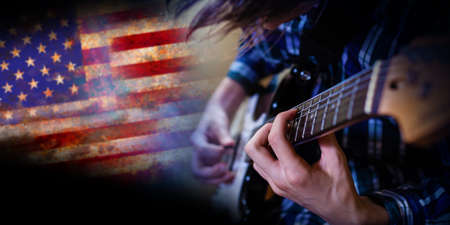 Electric guitar man playing on US flag background. Closeup Photography. Banque d'images