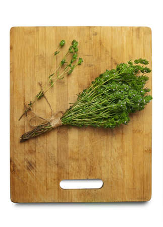 Thyme Bush on the cutting Board isolated on white background.