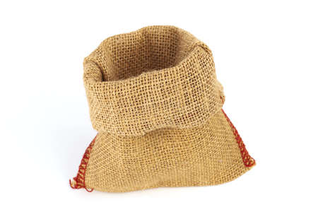 Empty burlap bag or sack to be filled in isolated on white background
