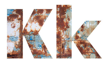 Rusty metal letter K. Old metal alphabet isolated on white background. Banco de Imagens