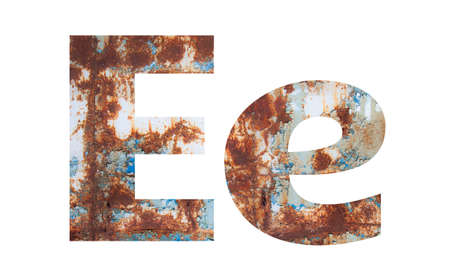 Rusty metal letter E. Old metal alphabet isolated on white background. Banco de Imagens