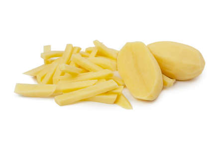 Raw Potato sliced strips prepared for French fries isolated on white background. Banco de Imagens