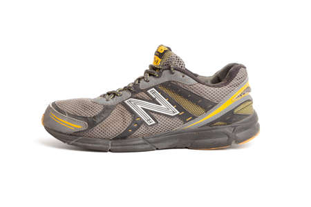 Chisinau, Moldova - April 30, 2021: New Balance shoes. Dirty old New Balance 470 v3 running trainers with holes in on a white background Editorial