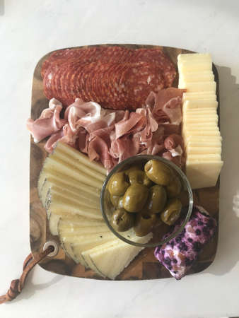 Beautiful Charcuterie Board with Delightful Meats, Cheeses, and Olives