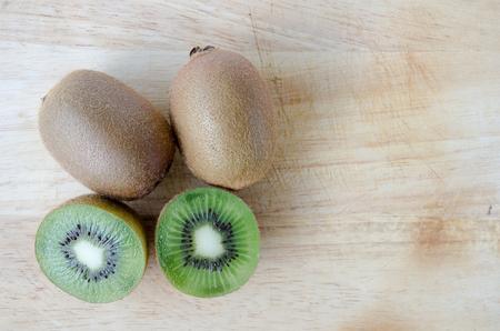 kiwifruit: kiwifruit on wood background Stock Photo