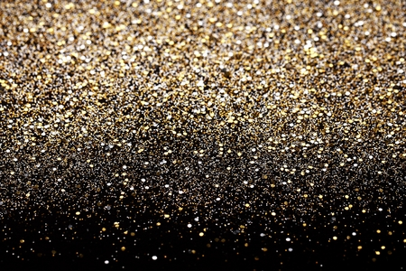 Christmas Gold and Silver Glitter background. Holiday abstract texture Imagens