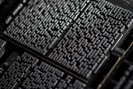 Macro shoot of an old vintage Victorian newspaper book printing press background