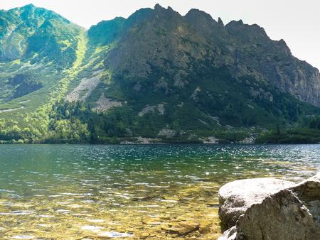 Beautiful lake Popradske pleso in high Tatras mountains in Slovakia. Stock Photo