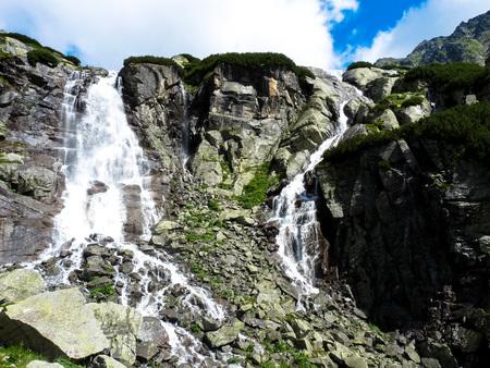 Skok waterfall, High Tatras mountains in Slovakia on a summer day. Stock Photo