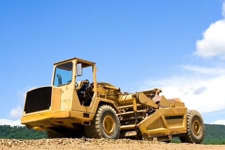 earthmover: An earthmover on a construction site. Stock Photo