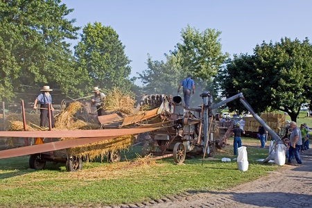 Kinzers,Pennsylvania-August 17,2011:Demonstration of a vintage threshing machine Editorial