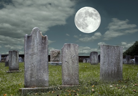 An old graveyard in the light of the full moon Stock Photo
