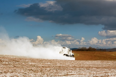 A truck spreading powdered limestone on farmland to improve soil properties  Lancaster County,Pennsylvania,USA