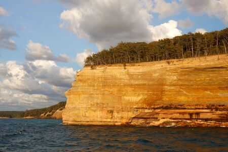 Pictured Rocks National Lakeshore in evening sunlight These colorful formations are on the Lake Superior shoreline on Michigan