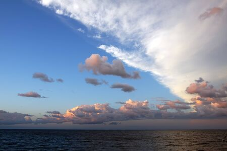 Cloud formation over a large body of water at sunset Stock Photo - 15440547