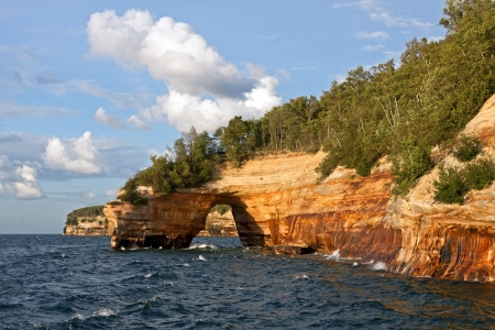 Pictured Rocks National Lakeshore in evening sunlight These colorful formations are on the Lake Superior shoreline on Michigan photo