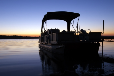 A boat silhouetted in the sunrise Stock Photo - 16033890