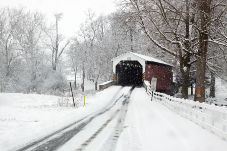 Snowing at a covered bridge in Lancaster County,Pennsylvania,USA  Stock Photo