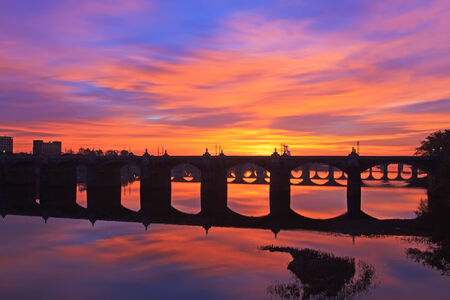 A colorful sunrise over the many old bridges crossing the Susquehanna River in Harrisburg, Pennsylvania, USA