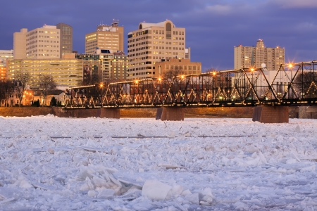 Nighttime view of ice breaking up on the Susquehanna River at Harrisburg, Pennsylvania, USA