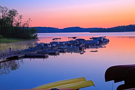 Boats at sunrise on Lake Marburg in Codorus State Park, York County, Pennsylvania, USA  Stock Photo