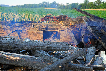 smoldering: The smoldering remains of a rural home which was completely destroyed by fire  Stock Photo