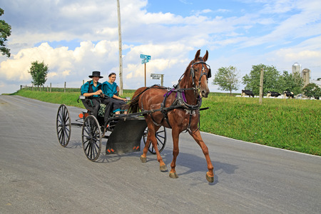 LEOLA, PENNSYLVANIA - AUGUST 31: A young Amish couple out for a buggy ride on August 31, 2014 in Leola, PA.