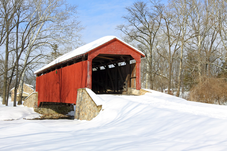 Pool Forge Covered Bridge with snow in Lancaster County, Pennsylvania, USA. Stock Photo