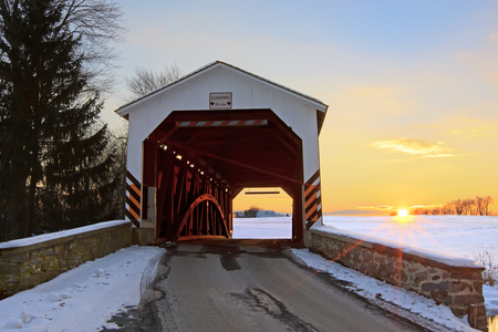 A covered bridge at sunset in Lancaster County, Pennsylvania, USA. photo