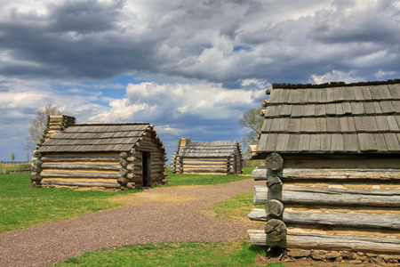 encampment: Reproductions of cabins used by Revolutionary War soldiers during the winter of 1777-78 under the command of George Washington. Located in Valley Forge National Historical Park, Pennsylvania, USA.