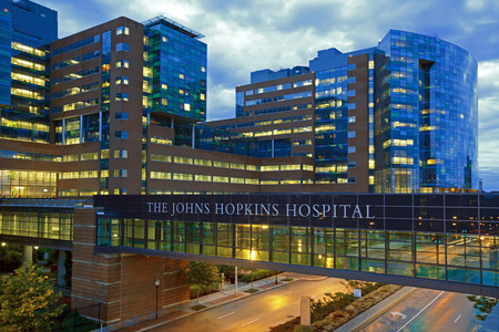 BALTIMORE - JUNE 28: The Johns Hopkins Hospital at night from Orleans Street on June 28, 2015 in Baltimore, Maryland. The Johns Hopkins Hospital is a teaching hospital and biomedical research facility. Editorial