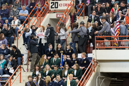 escorted: HARRISBURG, PENNSYLVANIA - JANUARY 09, 2016: Animal welfare activists are escorted out of the arena as they attempt to interrupt Pennsylvania Governor Tom Wolfs opening ceremony speech at the Farm Show Complex on January 09, 2016 in Harrisburg, Pennsylva