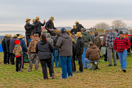 auctioneer: PENRYN, PENNSYLVANIA - MARCH 19, 2016: Annual Amish  Mud Sale to benefit Penryn Fire  and  Limerock Parochial School. Sale items include quilts, tools, food, crafts, farm equipment and antiques.