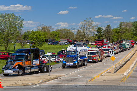 world record: LANCASTER, PENNSYLVANIA - MAY 8, 2016: Make-A-Wish Foundation shatters world record for largest convoy, draws 590 trucks. On the Mothers Day annual fundraiser truckers grant a Lancaster County wish ride to children with life-threatening illnesses.