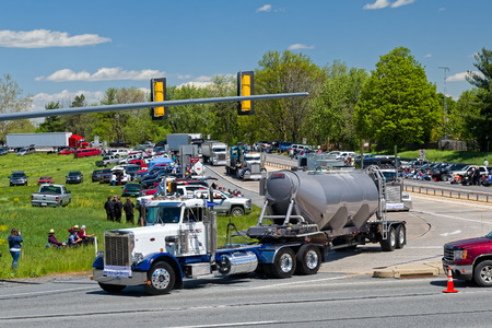 convoy: LANCASTER, PENNSYLVANIA - MAY 8, 2016: Make-A-Wish Foundation sets a new Guinness World Record for the largest truck convoy with 590 trucks. On the Mothers Day annual fundraiser truckers grant a Lancaster County wish ride to children with life-threatenin