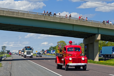 convoy: LANCASTER, PA - MAY 8, 2016: Make-A-Wish Foundation sets a new Guinness World Record for the largest truck convoy.  Truckers grant a Lancaster County ride to children with life-threatening illnesses. Editorial